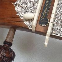 This is custom work tun wood surbahar